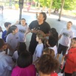 Brian Grant visits Irvington Elementary for ML20 graduation day with the students